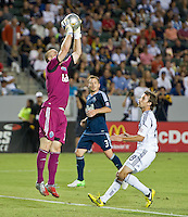 CARSON, CA - September 1, 2012: Vancouver goalie Brad Knighton (18) and defender Jordan Harvey (3) and LA Galaxy forward Mike Magee (18) during the LA Galaxy vs the Vancouver Whitecaps FC at the Home Depot Center in Carson, California. Final score LA Galaxy 2, Vancouver Whitecaps FC 0.
