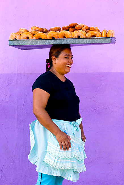 Portrait of a Nicaraguan woman selling freshly made donuts in Granada, Nicaragua.