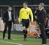 DC United head coach Ben Olsen talks to the 4th referee Daniel Fitzgerald after a call.  DC United tied The Colorado Rapids 1-1, at RFK Stadium, Saturday  May 14, 2011.