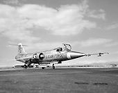 """1961 photo of an F-104.  Known as """"the missile with a man in it,"""" the stubby-winged Lockheed F-104 Starfighter was the first U.S. jet fighter in service to fly Mach 2, twice the speed of sound. Designed as a high-performance day fighter, the F-104 had excellent acceleration and top speed. It first flew on February 7, 1954.   While built for the United States Air Force, most Starfighters were flown by other countries, particularly Canada, Italy, Germany, and Japan. Many were built under license overseas.  The National Aeronautics and Space Administration (NASA) flew this F-104A for 19 years as a flying test bed and a chase plane. It was used to test the reaction controls later used on the North American X-15..Credit: U.S. Air Force via CNP"""