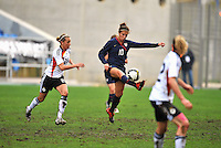 Carli Lloyd soars to kick the ball.  .The USA captured the 2010 Algarve Cup title by defeating Germany 3-2, at Estadio Algarve on March 3, 2010.