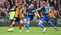 20170415 - LENS , FRANCE : Lens' Abdellah Zoubir (L) with Auxerre's Gaetan Courtet (R) and Lionel Mathis (M) pictured during the soccer match between Racing Club de LENS and AJ Auxerre , on the thirty third matchday in the French Dominos pizza Ligue 2 at the Stade Bollaert Delelis stadium , Lens . Saturday 15 April 2017 . PHOTO DIRK VUYLSTEKE | SPORTPIX.BE