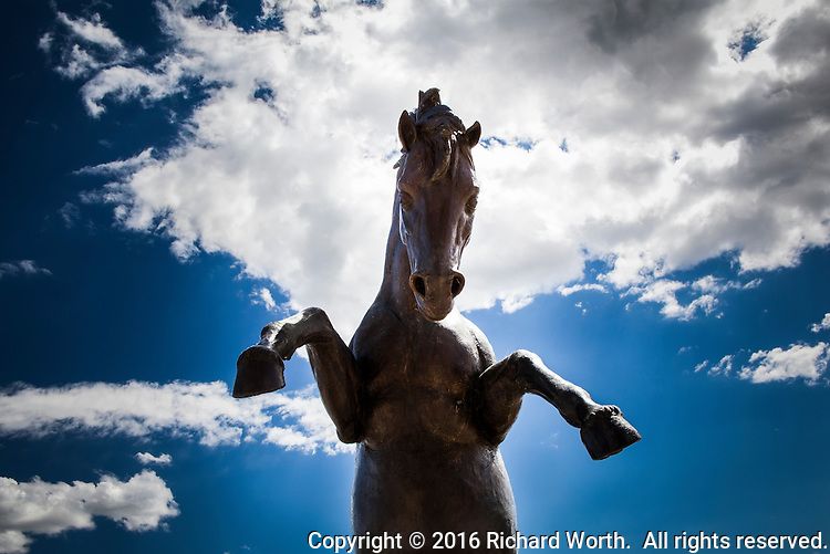 The lead bronco, the apex, in a sculpture of broncos charging up a rocky slope at Mile High Stadium, Denver, Colorado.