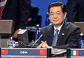 President Hu Jintao of China attends the opening plenary of the Nuclear Security Summit with United States President Barack Obama at the Washington Convention Center in Washington, D.C., U.S., on Tuesday, April 13, 2010. Ukraine's agreement to relinquish its entire stockpile of highly enriched uranium gave Obama the first concrete result for a summit he convened on securing the world's atomic material..Credit: Andrew Harrer / Pool via CNP