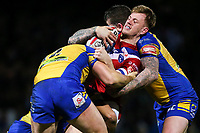Picture by Alex Whitehead/SWpix.com - 17/03/2017 - Rugby League - Betfred Super League - Leeds Rhinos v Wakefield Trinity - Headingley Carnegie Stadium, Leeds, England - Wakefield's Tom Johnstone is tackled by Leeds' Kallum Watkins, Carl Ablett and Brett Delaney.