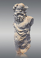 Roman statue of Silenus or Papposilenus from the mid 2nd cent. AD excavated from the Villa Spithoever, via Flavia, Rome, Italy. Papposilenus, the aged Silenus was tutor to Cionysus. In this statue he is portrayed with a hairy coat accentuating his wild nature. When the statue was complete it may have had its right arm held up grasping a bunch of grapes and a cup of wine in the left hand. The statue is copied from a late hellenistic original dating from 2nd cent. BC known as the satyr pouring wine by Greek sculptor Praxiteles circa 370-300 BC .  Inv  78294, The National Roman Museum, Rome, Italy