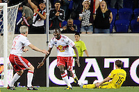 Tony Tchani (23) of the New York Red Bulls celebrates with John Wolyniec (15) after beating Brian Carroll (16) of the Columbus Crew on a header to score in th 81st minute. The Columbus Crew defeated the New York Red Bulls 3-1 during a Major League Soccer (MLS) match at Red Bull Arena in Harrison, NJ, on May 20, 2010.