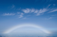 An Arctic phenomenon, a white rainbow or fogbow formed when sunlight refracts on cold fog, Barents Sea
