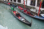 VENICE, ITALY - FEBRUARY 05: Trourists brave the weather sailing on a gondola along a partially frozen canal on February 5, 2012 in Venice, Italy. Italy as most of Europe is under a spell of very cold weather, it is more than 20 years aince the Venice Lagoon last froze.  (Photo by Marco Secchi/Getty Images)