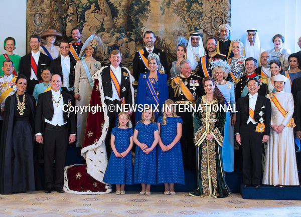 """30.04.2013; Amsterdam: KING WILLEM-ALEXANDER AND QUEEN MAXIMA.King Willem-Alexander and Queen Maxima pose for a group photograph with guests following the inauguration of King Willem-Alexander, at the Royal Palace in Amsterdam, The Netherlands.Mandatory Credit Photos: ©Pooro/NEWSPIX INTERNATIONAL..**ALL FEES PAYABLE TO: """"NEWSPIX INTERNATIONAL""""**..PHOTO CREDIT MANDATORY!!: NEWSPIX INTERNATIONAL(Failure to credit will incur a surcharge of 100% of reproduction fees)..IMMEDIATE CONFIRMATION OF USAGE REQUIRED:.Newspix International, 31 Chinnery Hill, Bishop's Stortford, ENGLAND CM23 3PS.Tel:+441279 324672  ; Fax: +441279656877.Mobile:  0777568 1153.e-mail: info@newspixinternational.co.uk"""