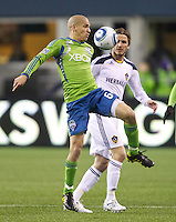 Seattle Sounders FC midfielder Osvaldo Alonso tries to keep the ball away from L.A. Galaxy midfielder David Beckham during play at Qwest Field in Seattle Tuesday March 15, 2011. The Galaxy won the game 1-0.