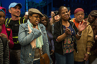 """NEW YORK APRIL 21 People singing Prince's songs at the Apollo Theater . During the course of his legendary career, Prince made several appearances at the famed Apollo Theater in Harlem, and the theater played his music as the marquee read """"Nothing Compares 2 U"""".The pop star die a few hours ago at the age of 57. in Harlem, New York City, Friday, April 21, 2016. Photo by VIEWpress/Maite H. Mateo"""