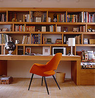 This study has a bespoke desk and shelves by Project Orange together with an orange 'Organic' chair designed by Eames and Saarinen