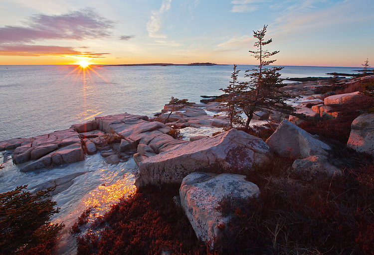 Winter sunrise and view of the coastline from the east side of the Schoodic Peninsula at Acadia National Park, Maine, USA