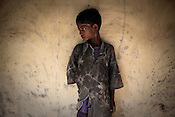 A Maria tribe boy is seen outside his house in village Godhari in Chattisgarh, India. Photo: Sanjit Das