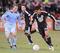 D.C. United midfielder Andy Najar (14) goes against Sporting Kansas City defender Seth Sinovic (16). Sporting Kansas City defeated D.C. United 1-0 at RFK Stadium,Saturday October 22, 2011.