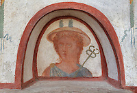 Fresco detail of Mercury, the winged messenger of the gods, with his caduceus, a staff with 2 entwined snakes, inside the niche of the Lararium, a shrine dedicated to the guardian spirits of the household, in the Casa del Criptoportico, or House of the Cryptoporticus, Pompeii, Italy. The lararium adjoins a peristyle garden and has a lower black border painted with plants and flowers. The house is one of the largest in Pompeii and was owned by the Valerii Rufi family and built in the 3rd century BC. It takes its name from the underground corridor or cryptoporticus used as a wine cellar and lit by small windows. Pompeii is a Roman town which was destroyed and buried under 4-6 m of volcanic ash in the eruption of Mount Vesuvius in 79 AD. Buildings and artefacts were preserved in the ash and have been excavated and restored. Pompeii is listed as a UNESCO World Heritage Site. Picture by Manuel Cohen