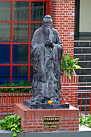 A statue stands in tribute to the ancient chinese phophet Confucius in the Maunakea Marketplace and food court in Chinatown, downtown Honolulu, Oahu