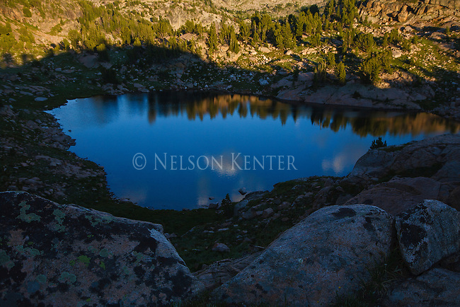 a small lake in the beartooth wilderness in montana below lonesome mountain