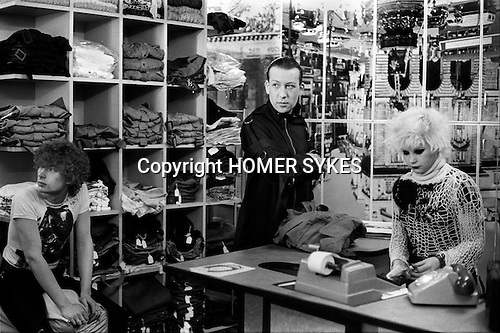 1970s fashion interior of the Malcolm McLaren and Vivienne Westwood's shop called Seditionaries at 430 Kings Road Chelsea London 1977. Blond shop assistant is Debbie Juvenile one of the coterie of early Sex Pistol fans known as the Bromley Contingent.