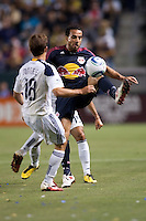 New York Red Bulls midfielder Dwayne De Rosario (11) beats LA Galaxy midfielder Mike Magee (18) to the ball. The LA Galaxy and Red Bulls of New York played to a 1-1 tie at Home Depot Center stadium in Carson, California on  May 7, 2011....