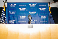 A microphone stands at a podium after real estate mogul and Republican presidential candidate Donald Trump spoke to supporters at a rally at the Weirs Beach Community Center in Laconia, New Hampshire.