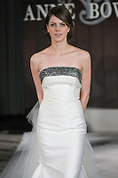 Model walks runway in a Mortimer wedding dress by Anne Bowen, for the Anne Bowen Bridal Spring 2012 runway show.