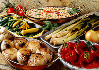 Prepared vegetables cooked in an outdoor wood burning oven; roasted peppers, leeks, onions, squash and beans.