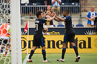 Michael Farfan (21) of the Philadelphia Union celebrates scoring with Gabriel Gomez (6). The Philadelphia Union defeated Toronto FC 3-0 during a Major League Soccer (MLS) match at PPL Park in Chester, PA, on July 8, 2012.