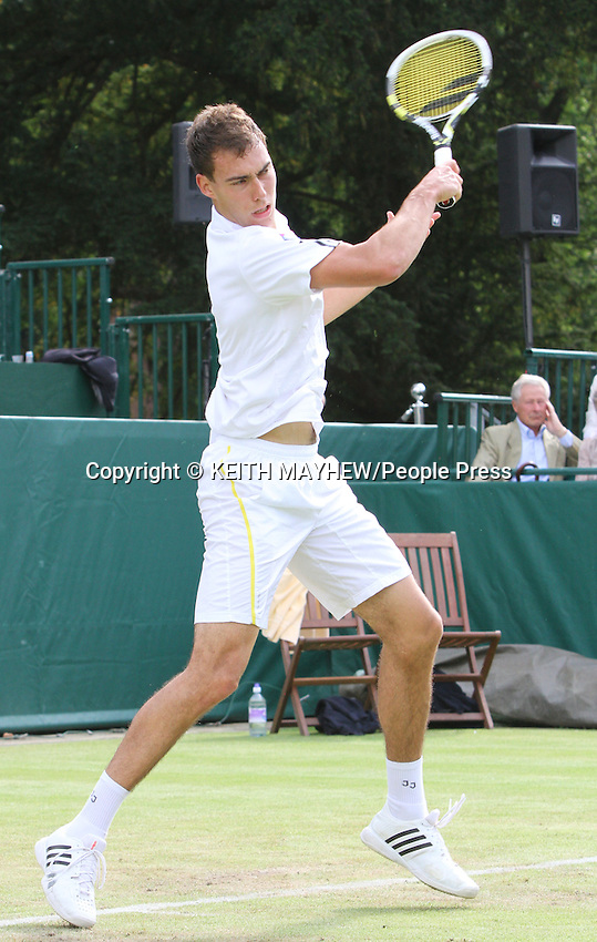 Jerzy Janowicz (Poland) plays Grigor Dmitrov (Bulgaria) at The Boodles Tennis Challenge held at Stoke Park, Buckinghamshire, UK - June 21st 2013<br /> <br /> Photo by Keith Mayhew