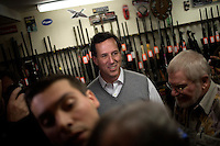 Former senator Rick Santorum walks through Pelletier's Sports Shop on a campaign stop in Jaffrey, New Hampshire, on Jan. 6, 2012.  Santorum is seeking the 2012 GOP Republican presidential nomination.