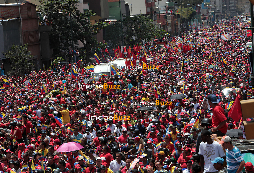 HUGO CHAVEZ SUPPORTERS MOURN HIS DEATH / General view during the march of the supporters of President Hugo Chavez through the streets of Caracas to the military academy on March 06, 2013 in Caracas, Venezuela.