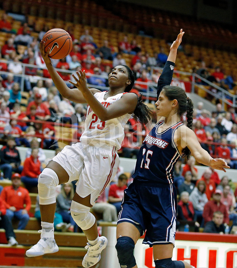 Kiara Lewis (23) of the Ohio State Buckeyes is guarded by Amadea Szamosi (15) of the Duquesne Lady Dukes during the Buckeyes' home opener at St. John Arena on Friday, November 11, 2016. Ohio State led 46-26 at halftime. (Barbara J. Perenic/The Columbus Dispatch)