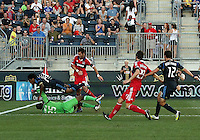 CHESTER, PA - AUGUST 12, 2012:  Sheanon Williams (25) of the Philadelphia Union jumps over  Sean Johnson (25) of the Chicago Fire during an MLS match at PPL Park, in Chester, PA on August 12. Fire won 3-1.