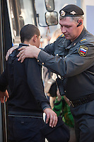 Moscow, Russia, 08/10/2011..Police search arrested youths in Manezhnaya Square by the Kremlin as they detain some 100 young men to prevent a rumoured demonstration in memory of soccer fan Andrei Uryupin, who died in a fight on October 2nd. A similar gathering in the square for the death of another fan in December last year attracted 5,000 people who chanted nationalist slogans, and dark-skinned passers-by were attacked.