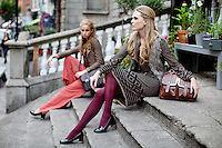 NO REPRO FEE. 31/8/2011. A|wear's new autumn '11 collection. Sarah Morrissey & Thalia Heffernan model a selection of dresses at the Powerscourt Town House Dublin. Sarah wears Black print dress - EUR45, Fur gilet - EUR55 and Black belt - EUR8Thalia wears a Paisley frill top - EUR35, Pleated palazzo pant -EUR50, Heritage blazer - EUR60,Brown satchel - EUR30 and Belt - EUR8. The full range is available in all A|wear stores and online at www.awear.com now. Picture James Horan/Collins Photos