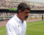 """UANL Tigres coach Ricardo """"Tuca"""" Ferreti leaves the green after being expelled by the referee Roberto Garcia Orozco during the first half time of the soccer match between UNAM Pumas and UANL Tigres at the University Stadium in Mexico City, April 23, 2006. UNAM Pumas tied 1-1 to UANL Tigres. Photo by Javier Rodriguez"""