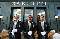 Switzerland. Canton Graubünden. St. Moritz. Hotel Carlton. Butlers. Stefan Kleinat (L), Gilles Ungright (C) head butler, Matheus Alcover (R).  © 2008 Didier Ruef .