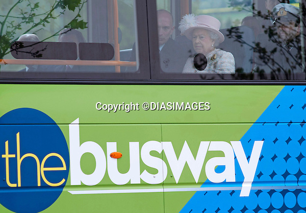 """THE QUEEN GETS ON THE BUS.Her Majesty followed in the footsteps of other Royals and has finally taken a bus ride..Arriving in Cambridge by train the Queen and Duke of Edinburgh took the Cambridgeshire Guided Bus on the world's longest guided busway, a short distance to the Medical Research Council Laboratory of Molecular Biology..Other Royals to have taken a bus ride include Prince Charles, Camilla, Duchess of Cornwall and Prince Harry while in New York..Mandatory Credit Photo: ©DIASIMAGES..**ALL FEES PAYABLE TO: """"NEWSPIX INTERNATIONAL""""**..IMMEDIATE CONFIRMATION OF USAGE REQUIRED:.Newspix International, 31 Chinnery Hill, Bishop's Stortford, ENGLAND CM23 3PS.Tel:+441279 324672  ; Fax: +441279656877.Mobile:  07775681153.e-mail: info@newspixinternational.co.uk"""
