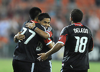 D.C. United forward Long Tan (27) celebrates his score in the 89th minute of the game with teammate Andy Najar (14) and Nick DeLeon (18) D.C. United defeated The Chicago Fire 4-2 at RFK Stadium, Wednesday August 22, 2012.