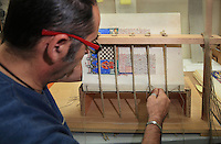 Alberto is assembling the folios of the facsimile with natural string at the printing studio of Scriptorium SL in Valencia, Spain. Picture by Manuel Cohen
