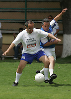 Mexican  right-wing National Action Party (PAN) candidate for Presidency Felipe Calderon plays a soccer match with reporters in a Mexico City school, March 20, 2006. A poll released by a Mexican newspaper indicates that leftist candidate Andres Manuel Lopez Obrador holds an 8 percentage point lead over ruling party candidate Felipe Calderon and PRI candidate Roberto Madrazo. Photo by Javier Rodriguez