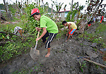 Jonalyn Caliñao digs a ditch for a water pipe as part of a cash for work program in the village of Cambayan in the Philippines province of Samar. The region was hit hard by Typhoon Haiyan in November 2013. Known locally as Yolanda, the storm left much of the community's infrastructure a shambles. Norwegian Church Aid, a member of the ACT Alliance, is helping the community rehabilitate its potable water system as well as build new toilets.