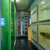 The narrow hallway leading from the kitchen incorporates deep storage cupboards with space-saving sliding doors lacquered in a Chinese 'parakeet green'