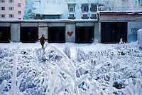 Snow-covered bushes, garages and houses in the city centre of Yakutsk. Yakutsk is one of the coldest cities on earth, with winter temperatures averaging -40.9 degrees Celsius.