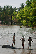 Children of Betio village play in the strong surf caused by the king tides which hit on the coast of the Pacific island of Kiribati. The high tides caused damage to homes and crops.The islands, and their way of life, are endangered by rising sea water levels which are eroding the fragile atoll, home to approximately 92,000 people.