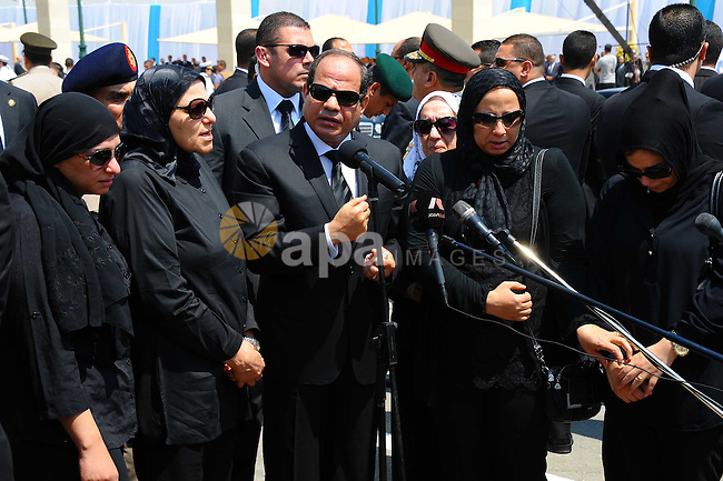 Egyptian president Abdel-Fattah el-Sissi, center, speaks at the funeral for Hisham Barakat, surrounded by his family members, the top judicial official in charge of overseeing the prosecution of thousands of Islamists, including former President Mohammed Morsi, on June 30, 2015. The Egyptian president promised to speed up proceedings against extremists by amending laws and freeing up the judiciary, a day after the country s top prosecutor was killed in a car bombing. Photo by Egyptian Presidency \ apaimages