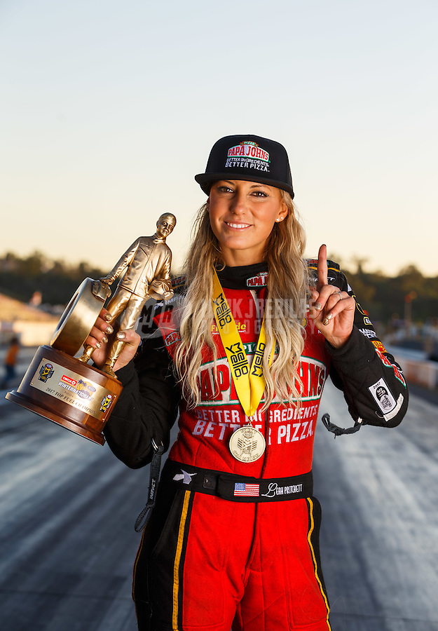 Feb 12, 2017; Pomona, CA, USA; NHRA top fuel driver Leah Pritchett poses for a portrait as she celebrates after winning the Winternationals at Auto Club Raceway at Pomona. Mandatory Credit: Mark J. Rebilas-USA TODAY Sports
