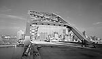 Pittsburgh PA:  View of Hilton Hotel and Fort Pitt Bridge construction from the Fort Pitt Bridge - 1959