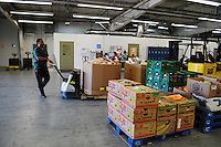 Phoenix, Arizona. October 18, 2012 - Ollie W. Belcher, Jr. -United Food Bank Supervisor of Operations- bring boxes of donated food into the warehouse. The United Food Bank provides food to other community organizations that in turn provide meals and snacks to Arizona families in need. As the amount of food donations decreases, food banks such as the United Food Bank strive to keep up with hunger relief needs of 1 in 5 (20%) of Arizonans who are living in poverty and, based on figures of the Department of Health and Human Services. Photo by Eduardo Barraza © 2012